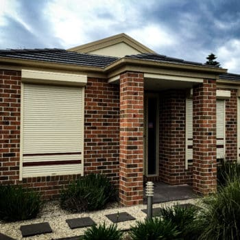 King Shutters and Screens Black Aluminium Roller Shutters on a Single Story Home Project in Melbourne