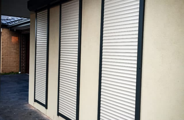 King Shutters and Screens White Aluminium Roller Shutters Project in Melbourne with Black Outlines