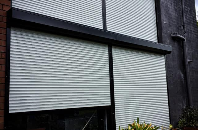 King Shutters and Screens White Aluminium Roller Shutters on a Commercial Project in Melbourne